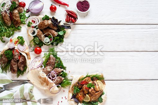 646207652istockphoto Grilled meat meals on white wooden table 646207584