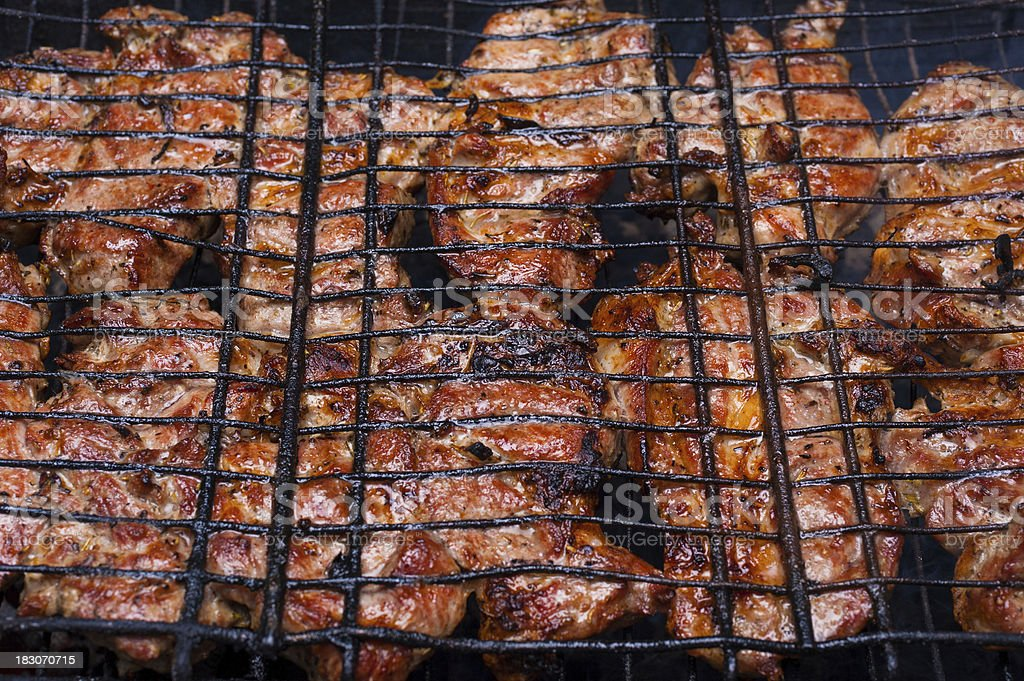 grilled meat on grill stock photo