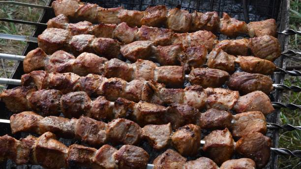 Grilled meat on skewers. Shish kebab fried on charcoal grill stock photo