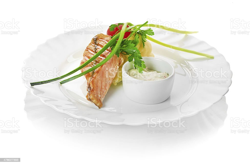 Grilled meat with trimmings royalty-free stock photo