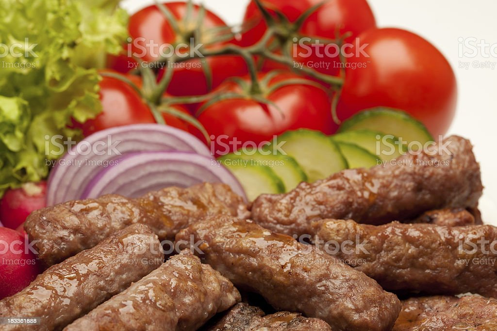 Grilled meat (kebabs) with vegetables royalty-free stock photo