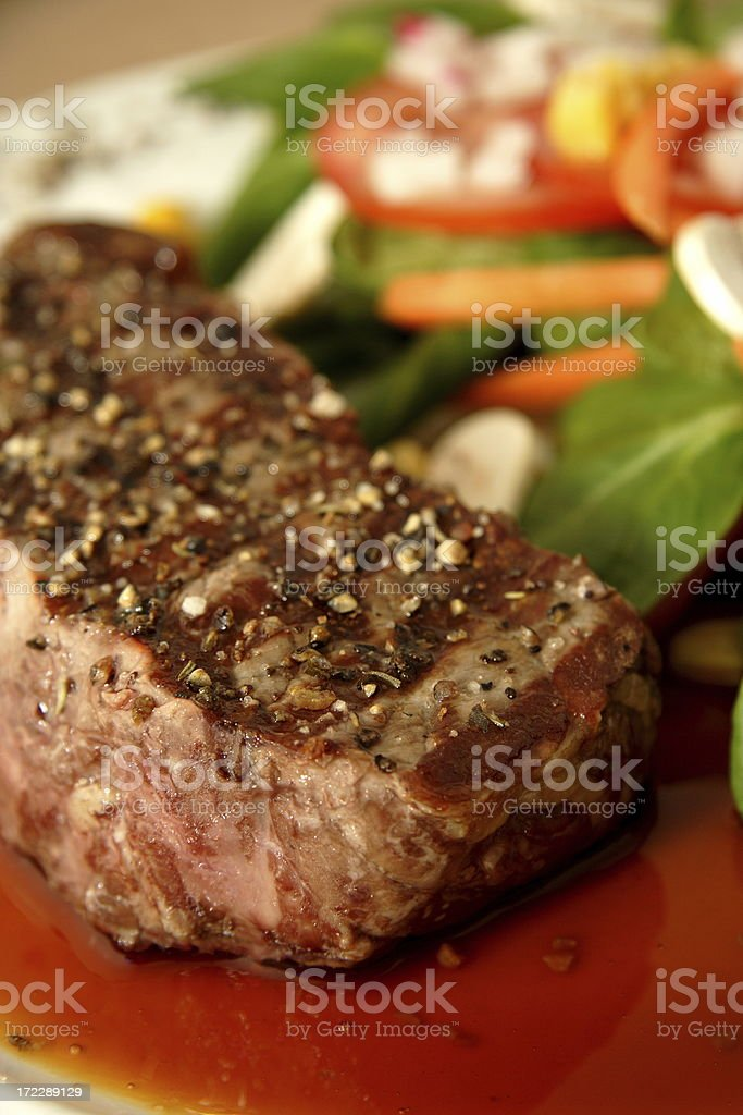 grilled New York Steak and salad royalty-free stock photo
