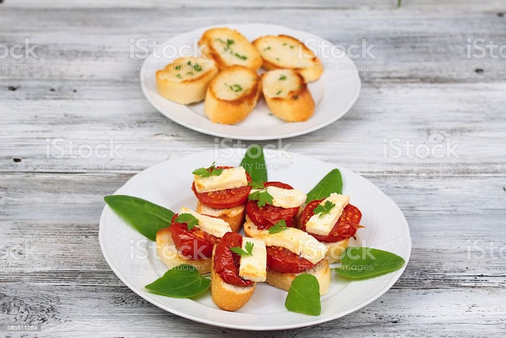 Grilled open sandwich with  tomato and  cheese stock photo