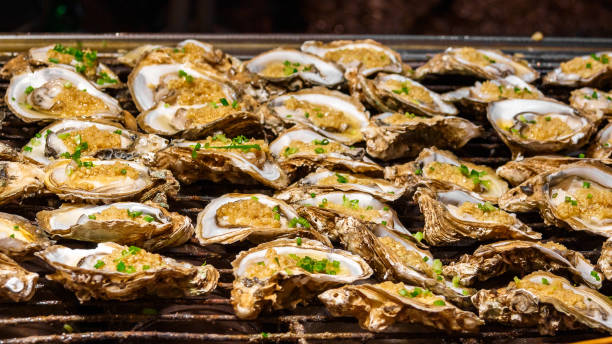 grilled oysters with rice - oyster stock pictures, royalty-free photos & images