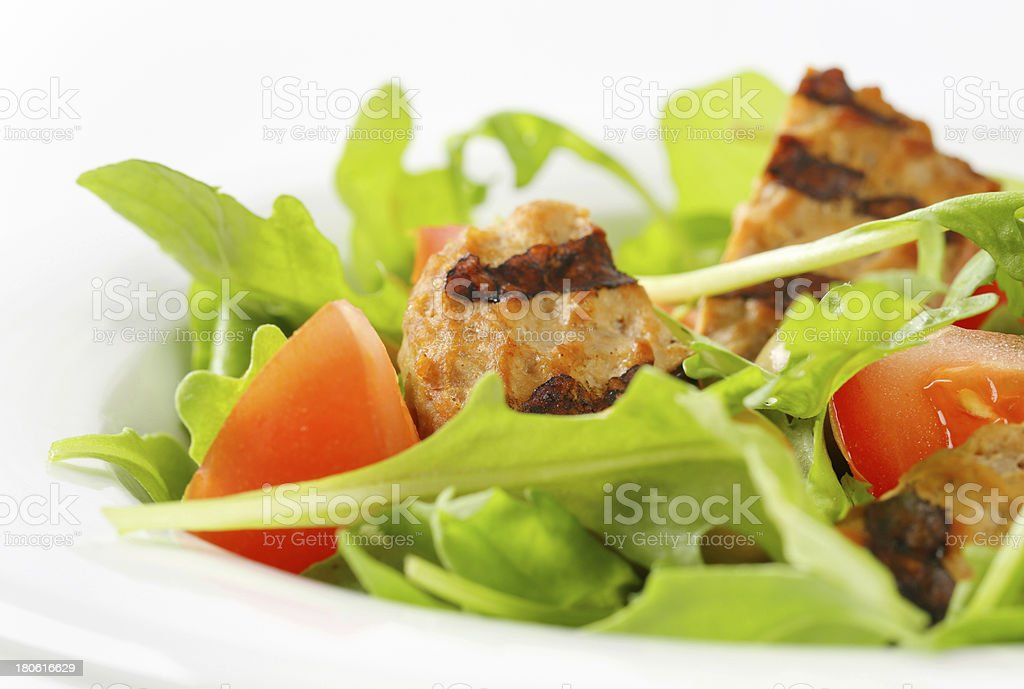 Grilled patty with fresh vegetable salad royalty-free stock photo