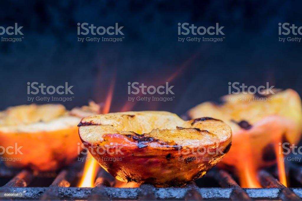 Grilled Peaches and Flames stock photo
