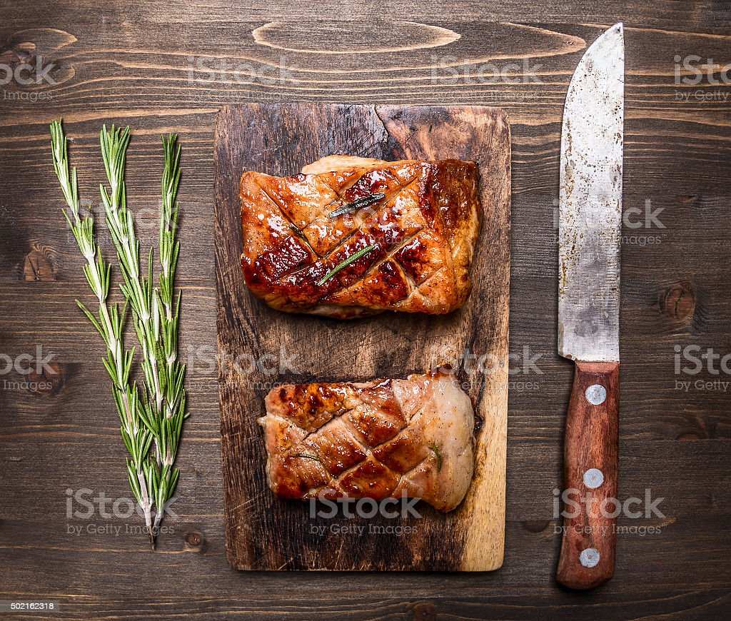 grilled piece pork  cutting board rustic background top view stock photo