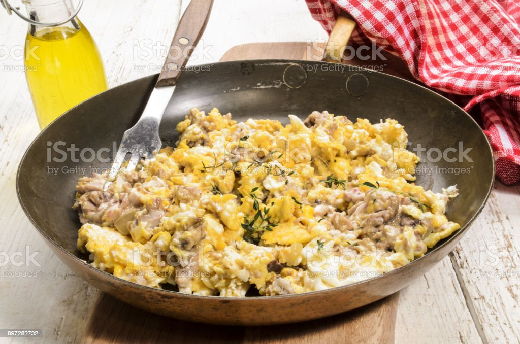 grilled pig brain with scrambled egg in a pan stock photo