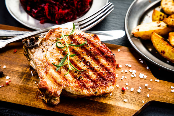 Grilled pork chop and vegetables Grilled pork chop and vegetables pork stock pictures, royalty-free photos & images