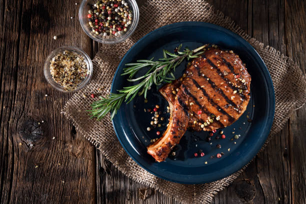 Grilled pork chop with spices stock photo