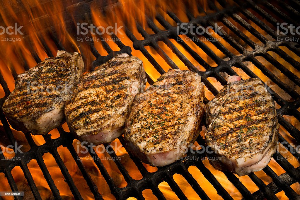 Grilled Pork Chops in Flames royalty-free stock photo