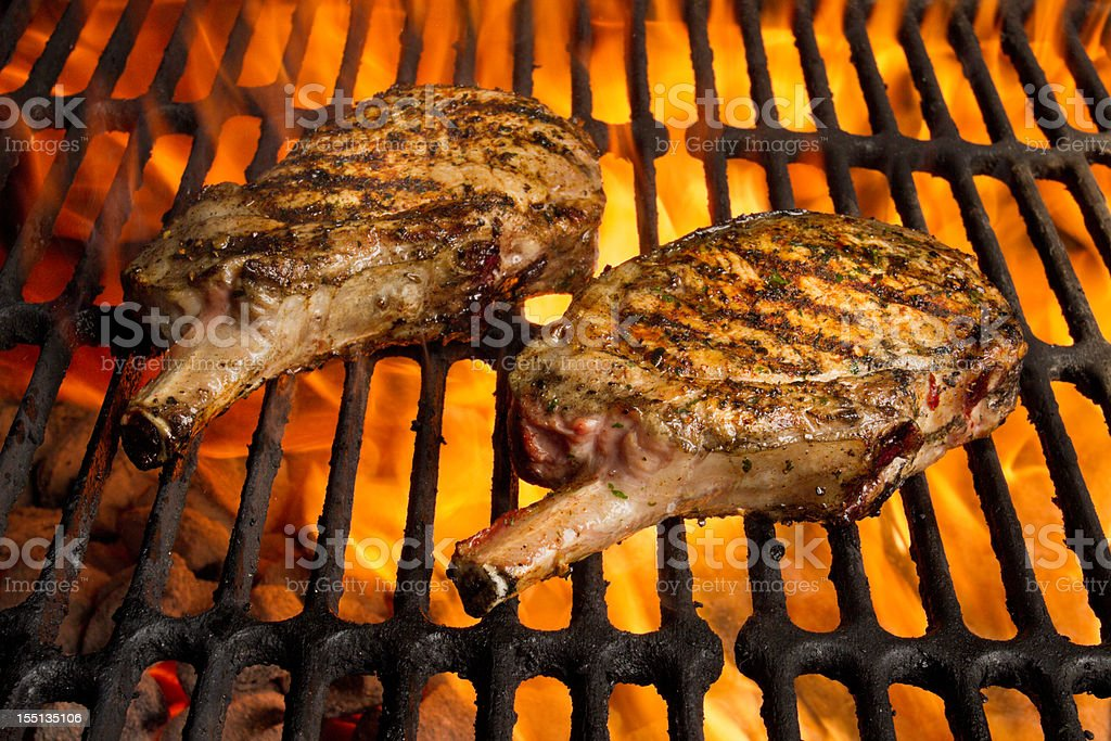Grilled Pork Chops in Flames stock photo