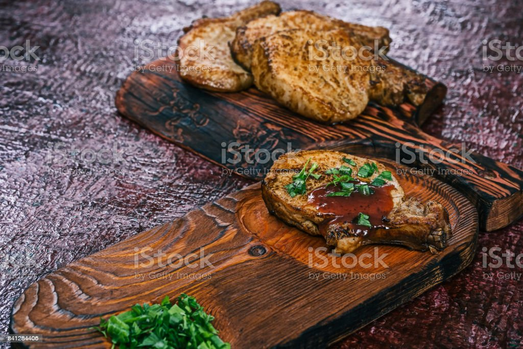 Grilled pork chops on wood stock photo