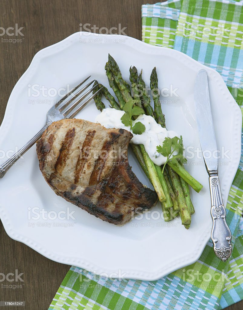 Grilled pork chops with asparagus royalty-free stock photo