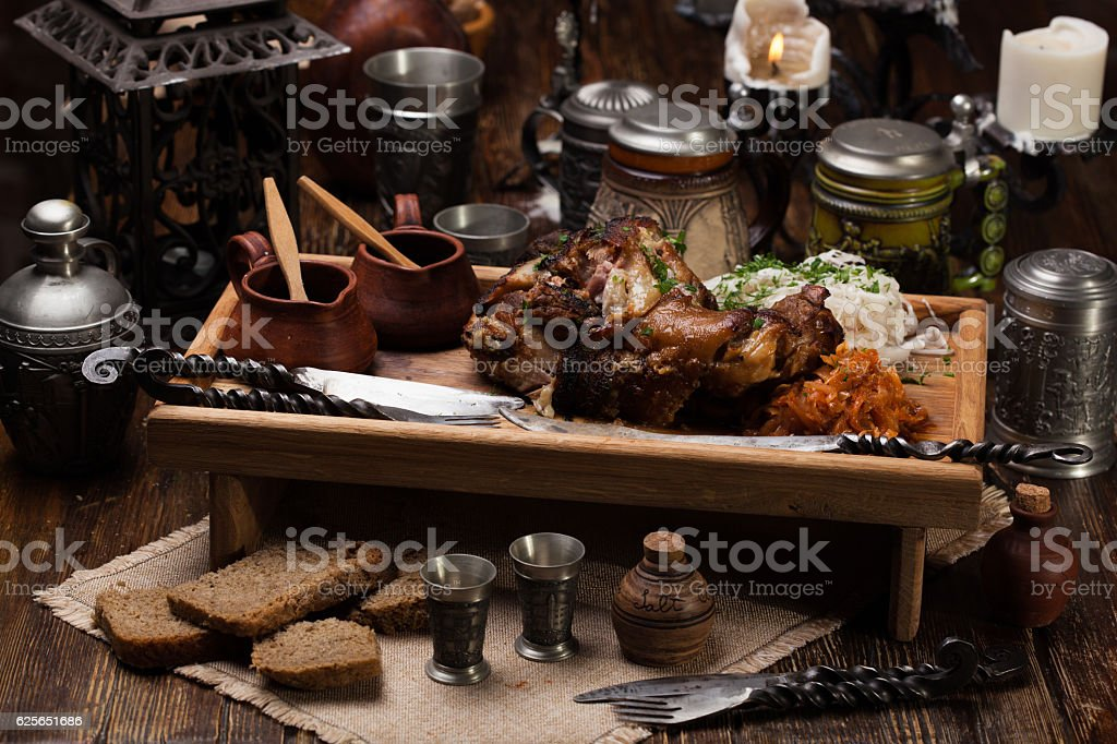 Grilled pork knuckle with sauerkraut. For a big company stock photo
