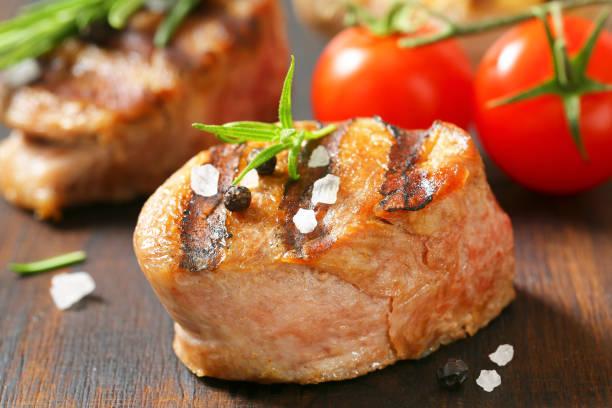 grilled pork medallion stock photo