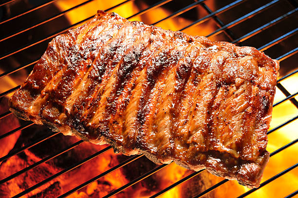 Grilled pork Grilled pork ribs on the grill. pork stock pictures, royalty-free photos & images