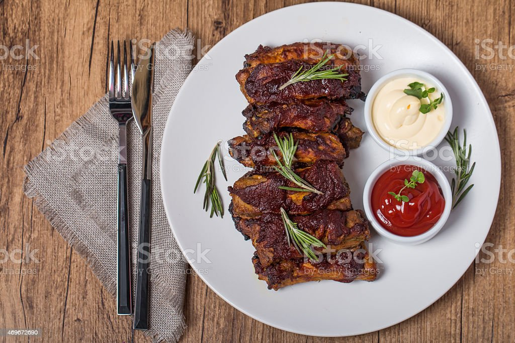 Grilled pork ribs in barbecue sauce stock photo
