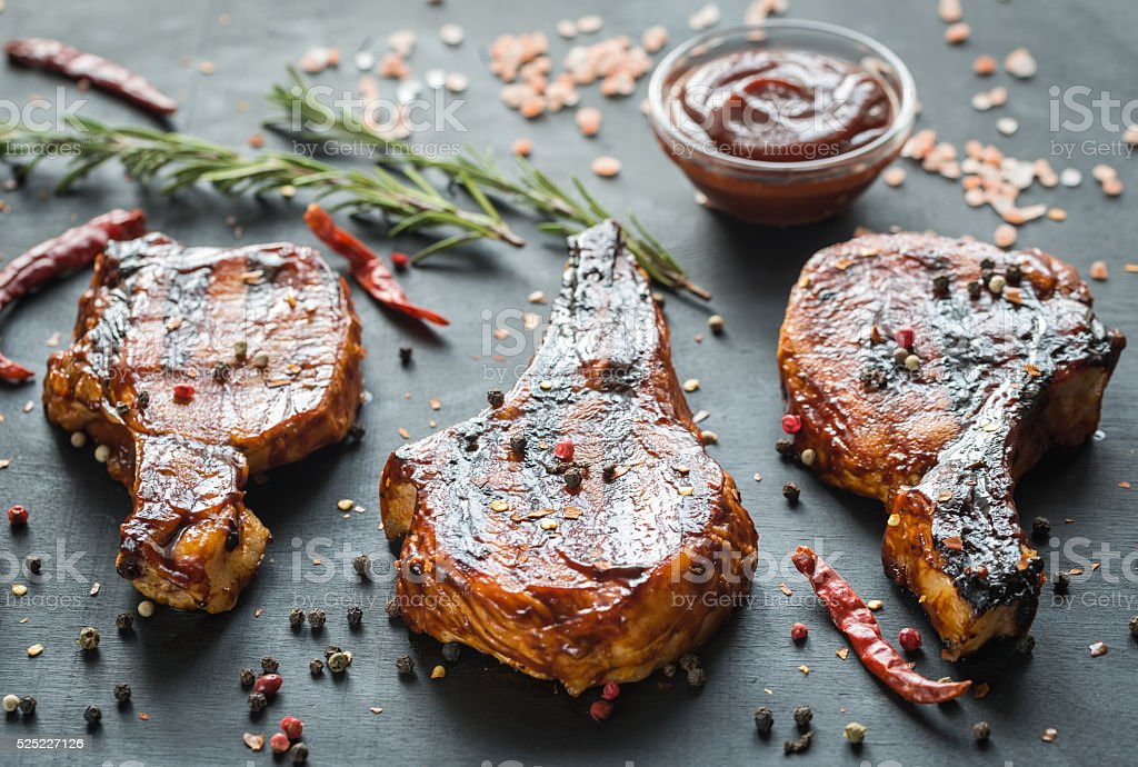 Grilled pork ribs on the wooden background stock photo