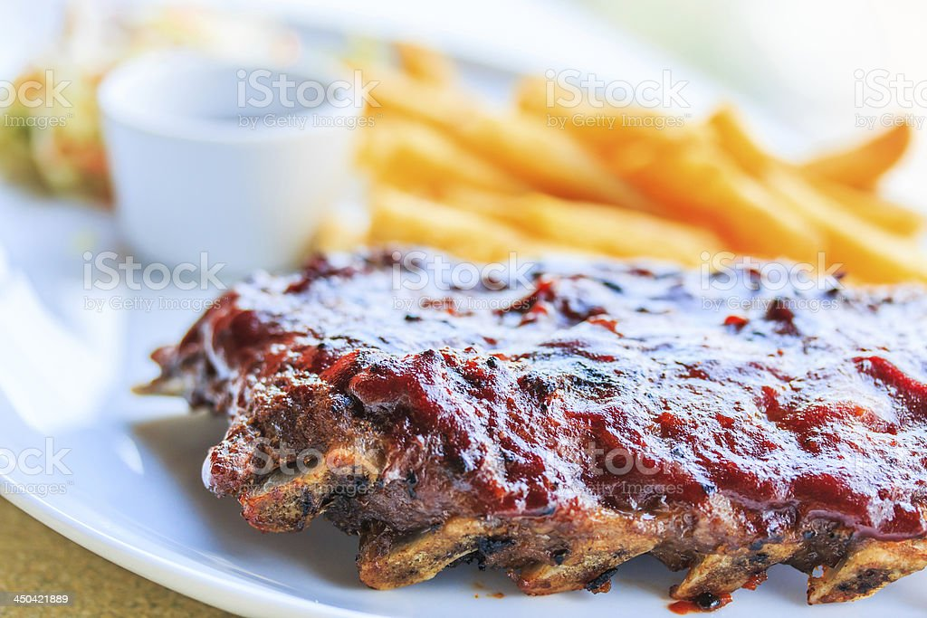 Grilled pork ribs. With tomato sauce stock photo