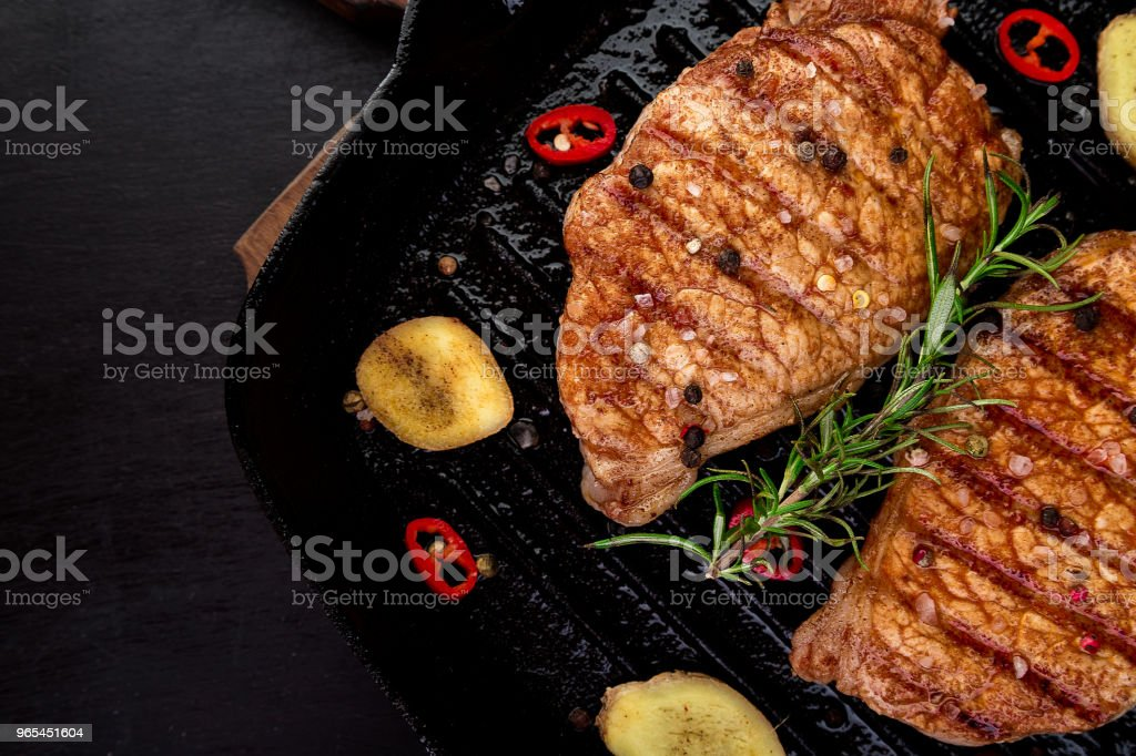 Grilled pork steak in grill pan royalty-free stock photo