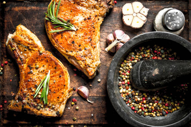 grilled pork steak with spices. - pepper seasoning stock photos and pictures