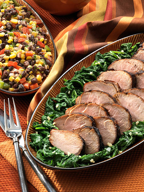 Grilled Pork Tenderloin with summer salad stock photo