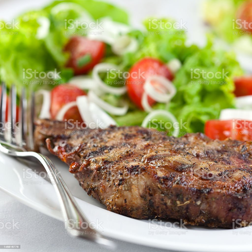 Grilled pork with herbs and salad royalty-free stock photo