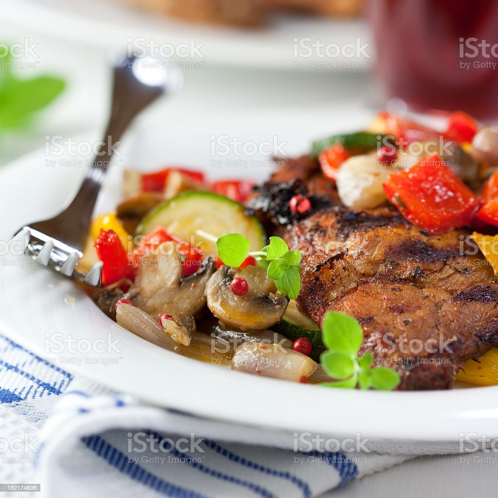 Grilled pork with vegetables and mushrooms royalty-free stock photo