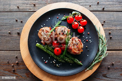 istock Grilled pork with vegetables and spices 516552316