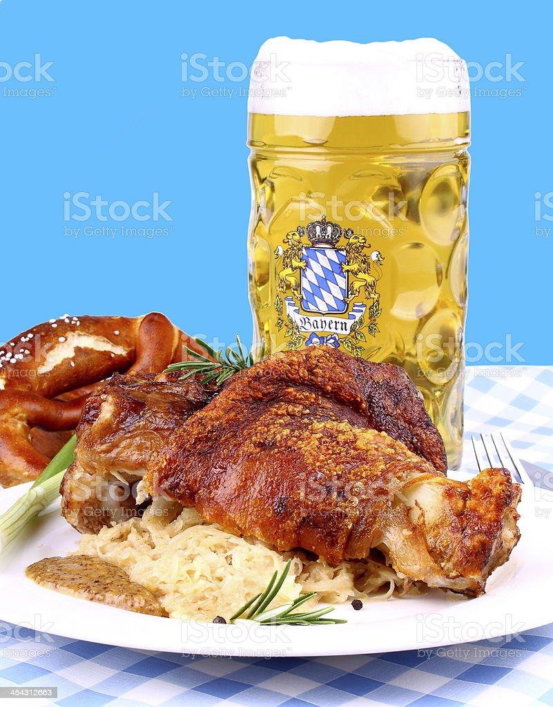 Grilled pork with whitish, sweet mustard and beer royalty-free stock photo