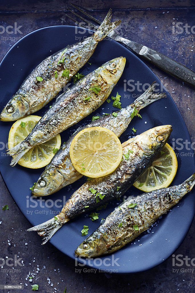Grilled Portuguese Sardines with Salt, Herbs and Lemon stock photo