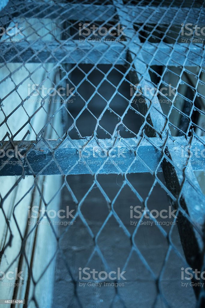 Grilled prison floor stock photo