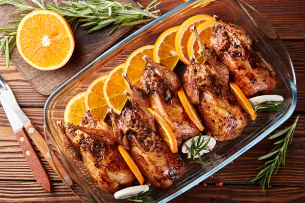 Grilled quails stuffed with mushrooms stock photo