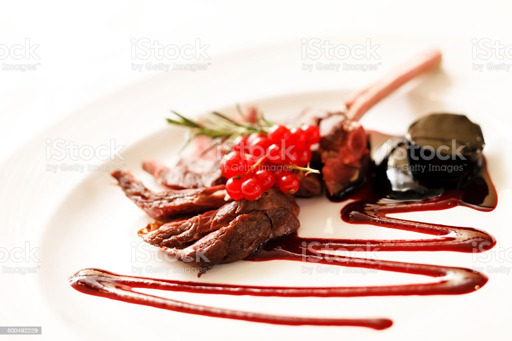 Grilled Rack of Lamb with red currant stock photo