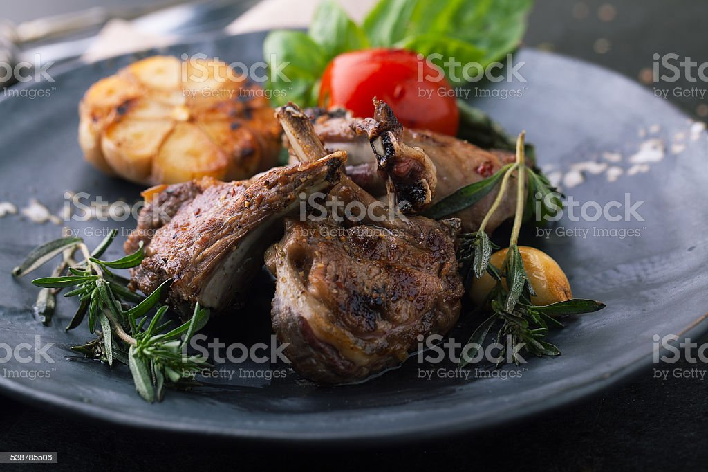 Grilled rack of lamb with vegetables stock photo