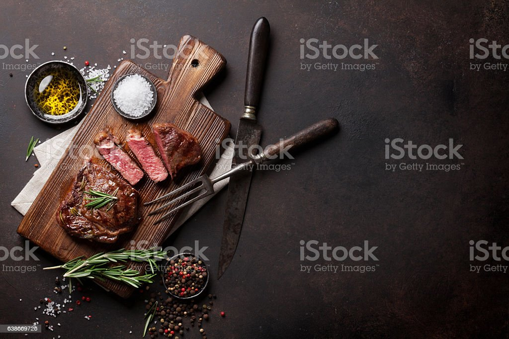 Grilled ribeye beef steak, herbs and spices royalty-free stock photo