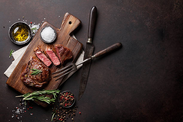 Grilled ribeye beef steak, herbs and spices stock photo