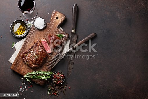 istock Grilled ribeye beef steak with red wine, herbs and spices 637890932