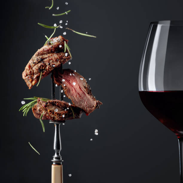 Grilled ribeye beef steak with rosemary on a black background. stock photo