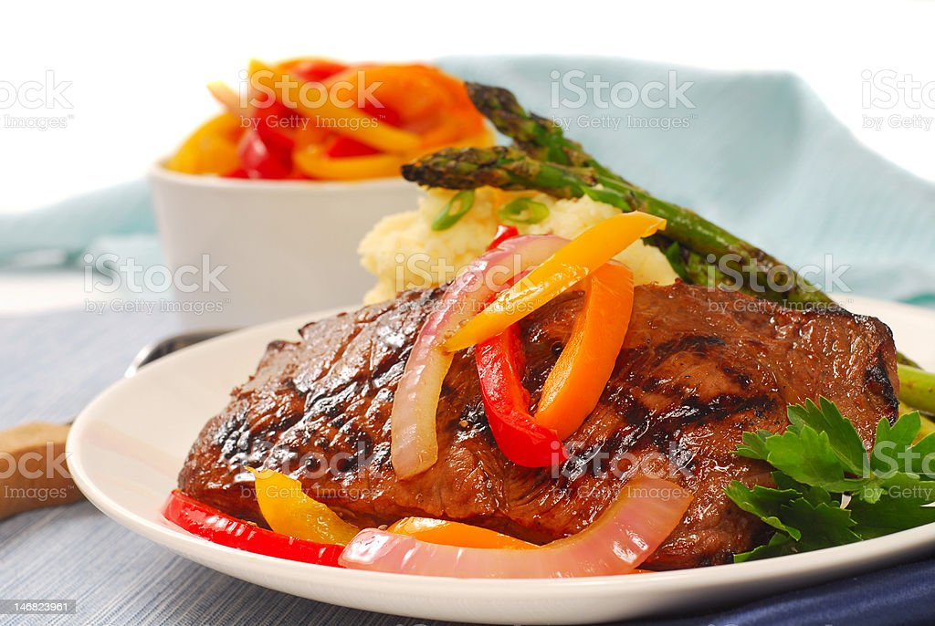 Grilled rib-eye steak with mashed potatoes stock photo