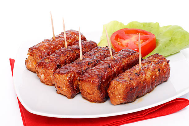 Grilled romanian meat rolls - mititei, mici stock photo