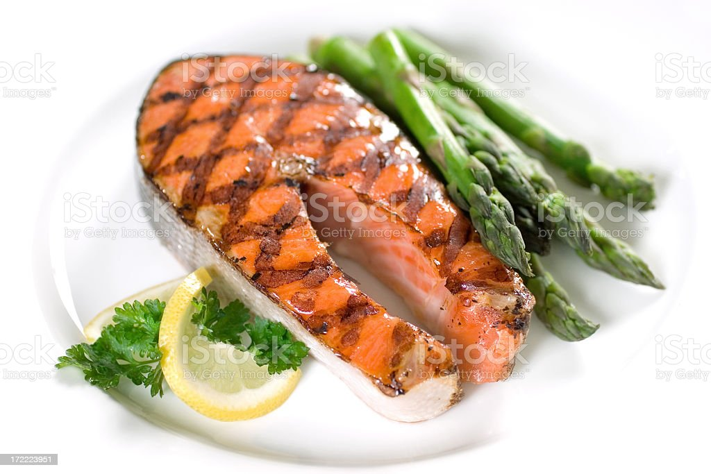 Grilled salmon and asparagus for dinner stock photo