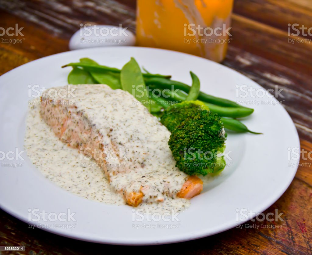 Grilled salmon and dill sauce. stock photo