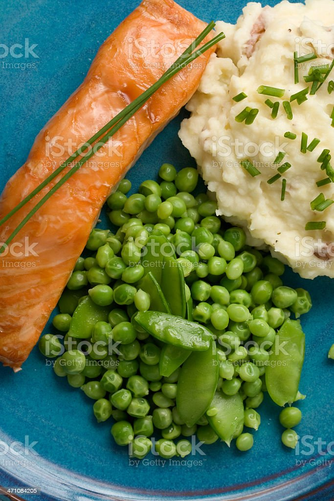 Grilled Salmon and Fresh Peas royalty-free stock photo