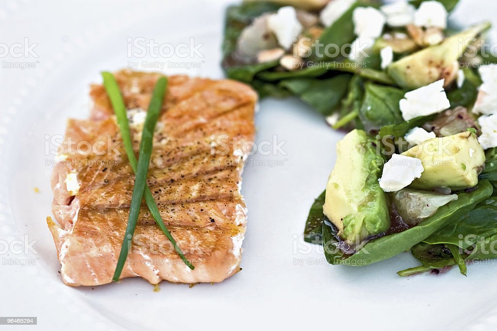Grilled Salmon and Spinach Salad royalty-free stock photo