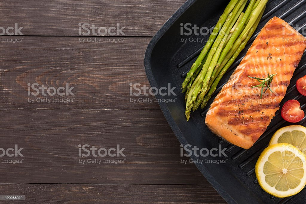 Grilled salmon cooked BBQ on a pan on wooden background stock photo