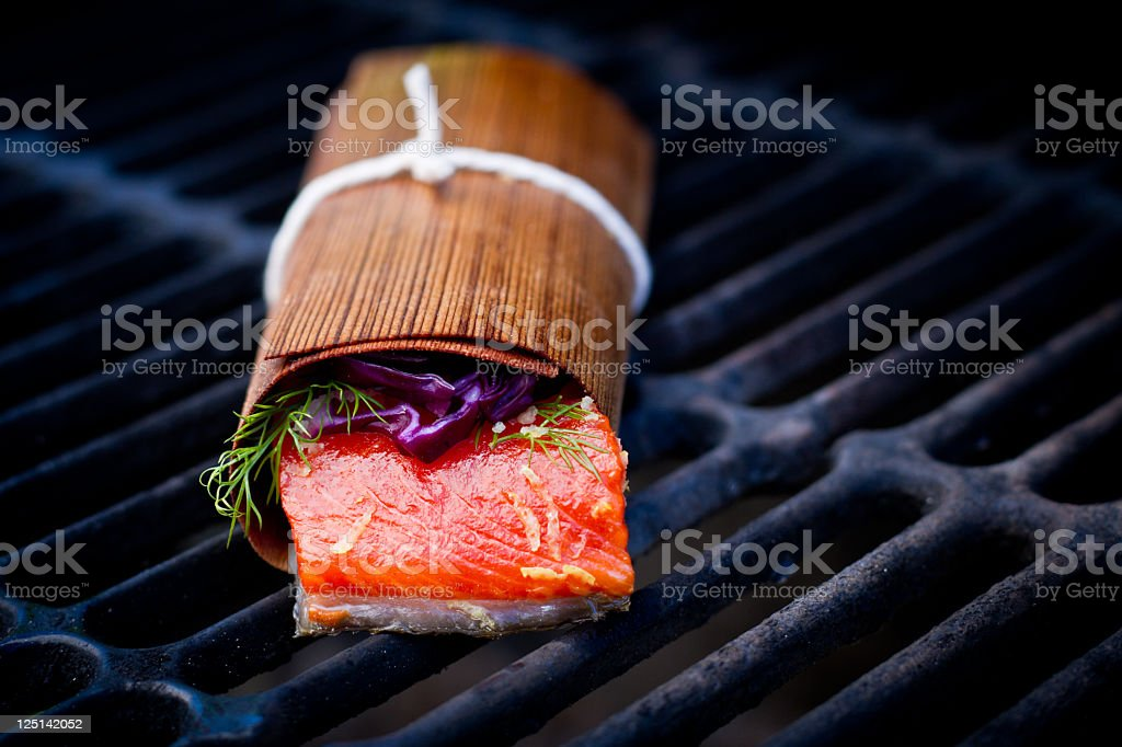 Grilled Salmon Filet in Cedar Paper stock photo
