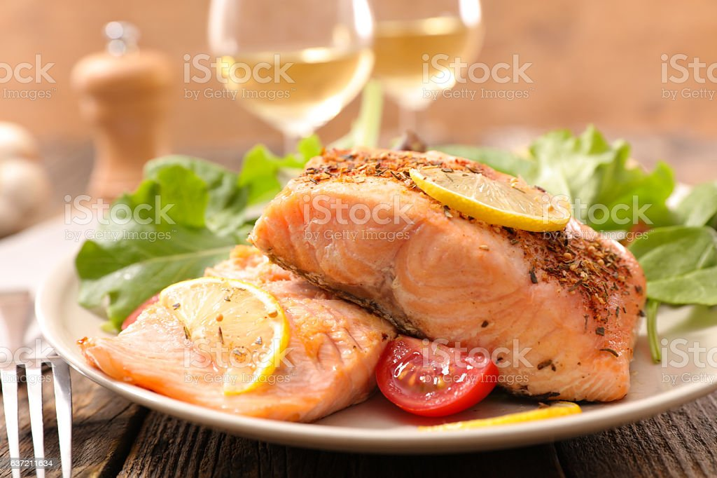 grilled salmon fish with salad stock photo