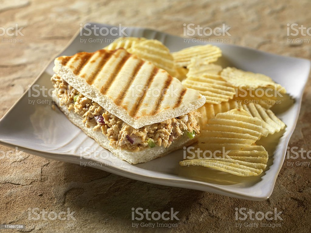 Grilled Salmon Panini with Chips royalty-free stock photo
